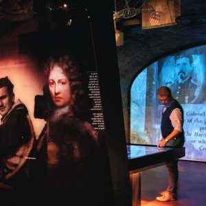 men looking at exhibits in epic ireland emigration museum
