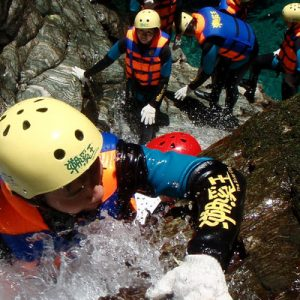 people climbing up against the stream during the river tracing in hualien