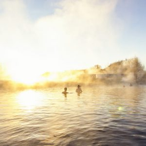 people bathing in a hot spring