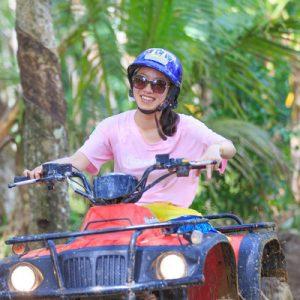 girl riding an atv