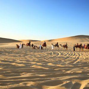 land cruiser dune bashing in the desert during sunset