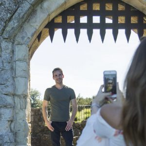 man and woman taking picture with leeds castle