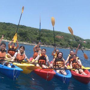 group of people kayaking by xiao liu qiu