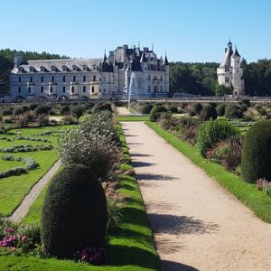 a view of Château de Chenonceau and its gardens
