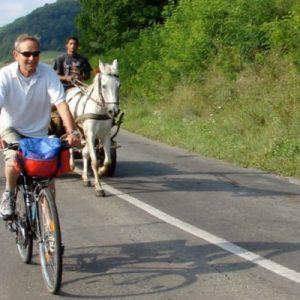 people biking along a road in Sibiu