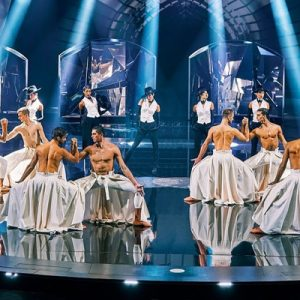 male dancers on stage in vivid grand show