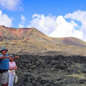 group looking at volcano at los volcanes natural park