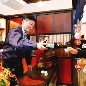 japanese man pouring sake