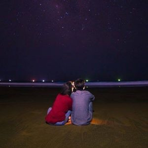 a couple gazing at the sky