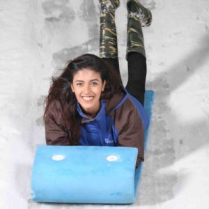 woman sledding in snow park city bangalore