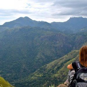woman looking at the views of the hills at ella rock