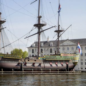 a ship in front of amsterdam maritime museum