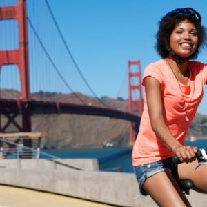 a woman riding a bicycle rented from Blazing Saddles Bike Shope