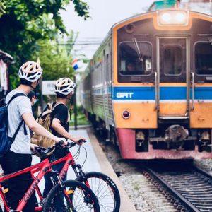 bangkok bike tour group waiting for train