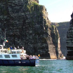 a cruise boat along cliffs of moher