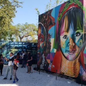 people admiring miami street art