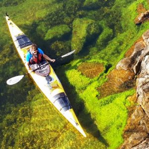 man kayaking in stockholm archipelago