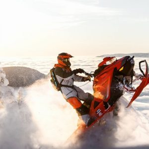 person snowmobiling