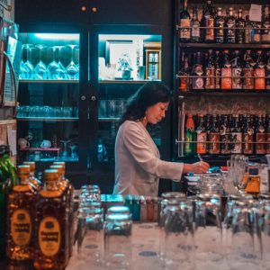lady preparing drinks in yamagata snack bar