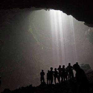tourists posing inside jomblang cave