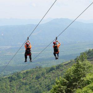 aerial view of two people zip lining lotte arai resort myoko niigata