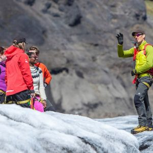 a glacier walking guide talking to tourists