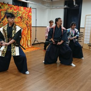 Group learning fighting style with instructor during Samurai ninja experience
