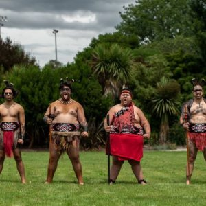 a group of maori dancers