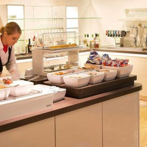 staff preparing food inside Amsterdam Airport Schiphol Aspire lounge