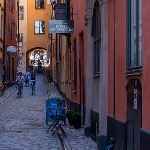 people biking through alleyway in soldermalm stockholm