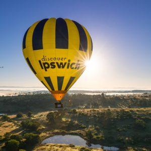 hot air balloon covering the sun