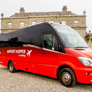 red and black airport hopper for Shared Dublin Airport (DUB) Hopper for Maynooth/Tallaght