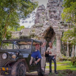 tourists pose for a photograph in angkor wat