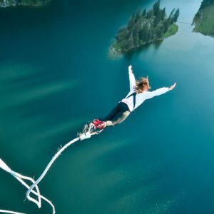 girl bungee jumping to lake stocksee