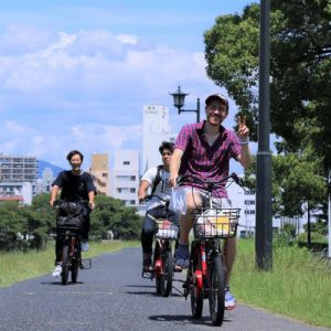 people biking in hiroshima