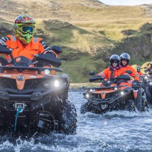 quad bikers driving along the Sólheimasandur expanse