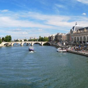 a view of the Seine River; Musée d'Orsay is on the right