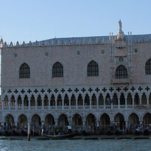 a section of St. Mark's Square in Venezia showing one of the buildings by the canal with many people