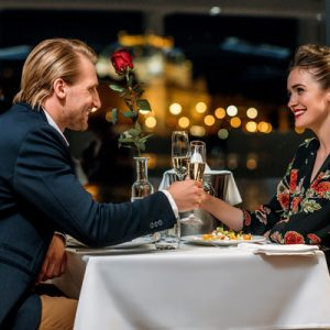 couple in a romantic dinner on deck of a cruise ship in prague