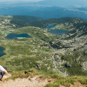 a woman on top of the mountian looking over rila seven lakes