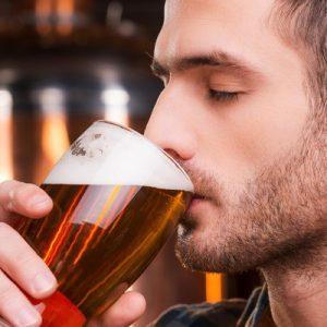 man tasting czech beer