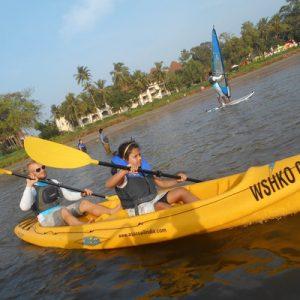 tourists enjoy kayaking in mandwa