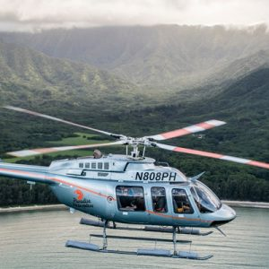 a tour helicopter flying around Oahu