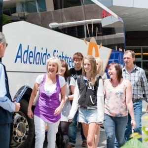 tourists in front of a sightseeing tour bus in adelaide
