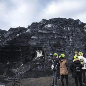 tourists at the base of Katla Volcano