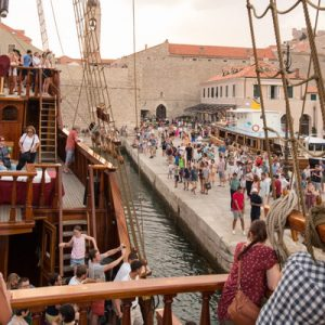 a bunch of people at the docks where the Karaka Dubrovnik boats are