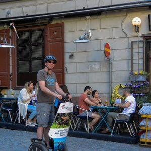 segway tour group driving past restaurant in stockholm sweden