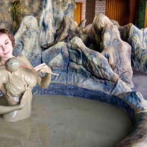 woman in mud bath at Galina Hotel and Spa