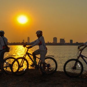 tourists biking in sunset