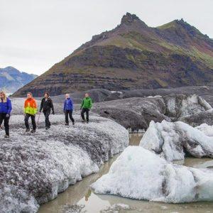 people walking somewhere on a Skaftafell outlet glacier